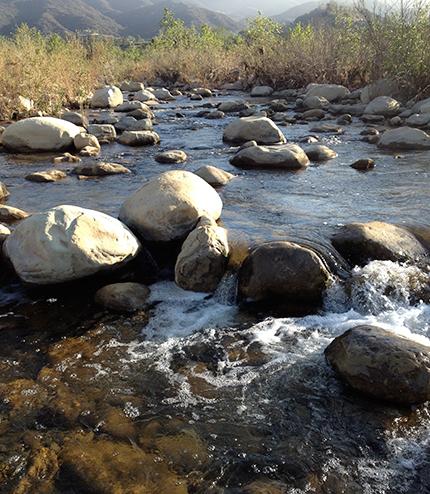 Water flowing over boulders in Ventura River.